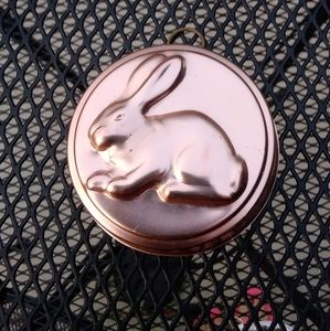 Vintage pink tin bunny jello mold wall decor